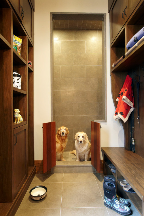 If you share your home with pets, the mudroom is the perfect spot for a gated pet shower and to store dog food, treats, leashes and blankets and towels.