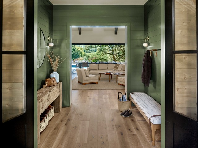 Entryway - cottage light wood floor and beige floor entryway idea in San Francisco with green walls and a black front door