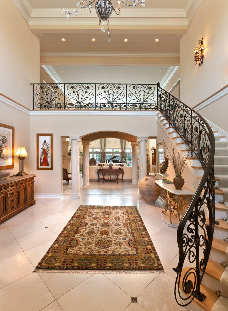 Inspiration for a mediterranean ceramic tile and beige floor foyer remodel in Milwaukee with beige walls