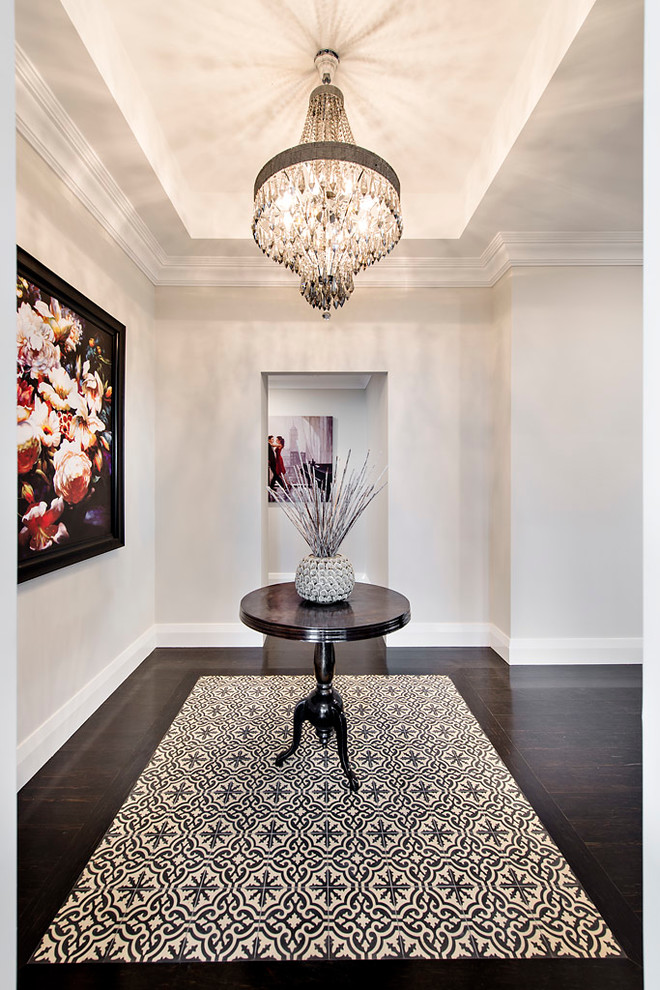 Inspiration for a transitional dark wood floor foyer remodel in Perth with white walls