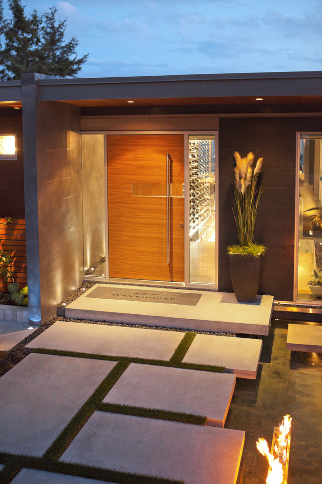 Example of a trendy entryway design in Vancouver with a medium wood front door