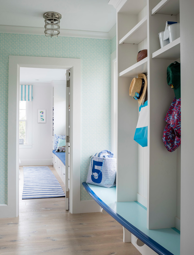 Beach style light wood floor mudroom photo in Bridgeport with green walls