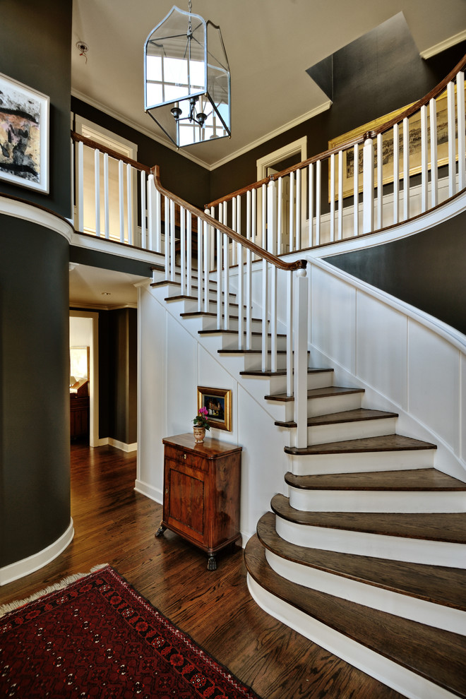 Inspiration for a large timeless dark wood floor and brown floor foyer remodel in Seattle with gray walls