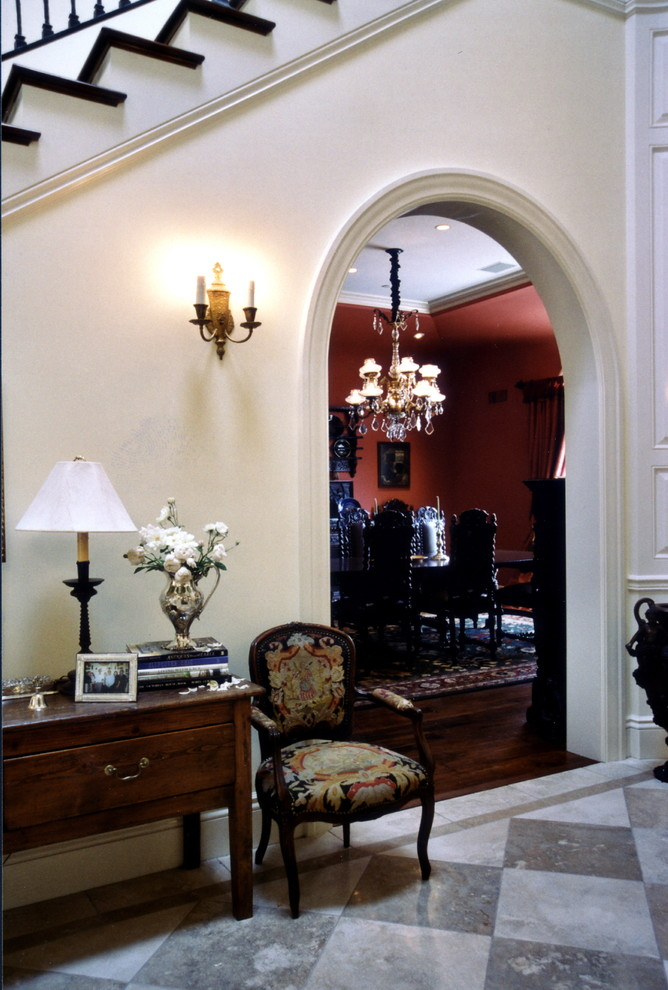 Example of a huge classic marble floor and beige floor entryway design in Los Angeles with beige walls and a glass front door