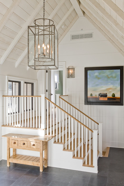 Example of a transitional foyer design in Boston with white walls