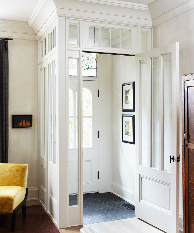 Example of a classic entryway design in Toronto with white walls