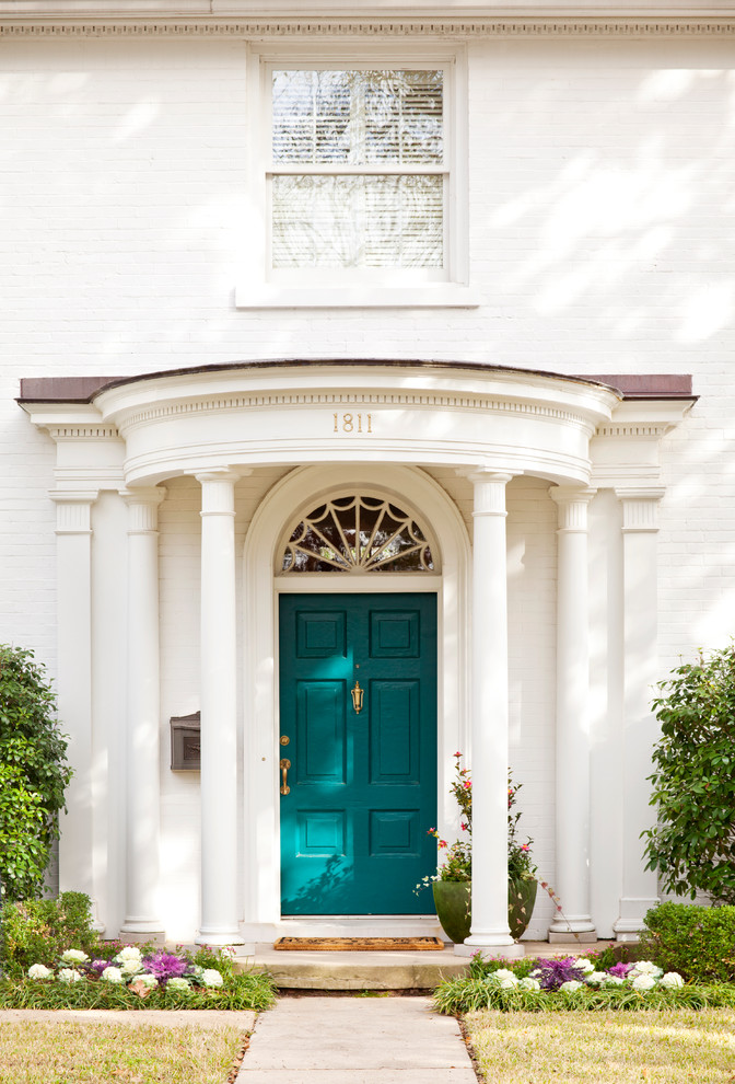 Inspiration for a timeless front door remodel in Other with a blue front door