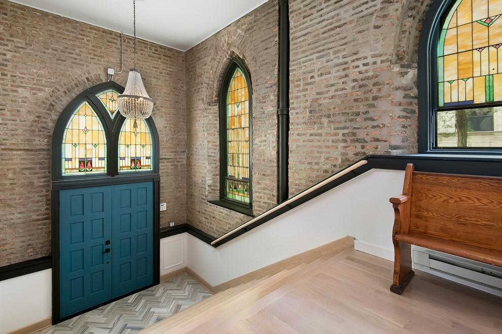 Elegant light wood floor and gray floor double front door photo in Chicago with a blue front door
