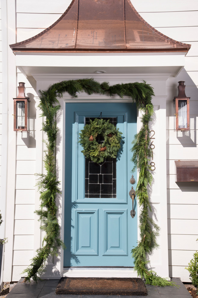 Entryway - traditional entryway idea in Houston with a blue front door