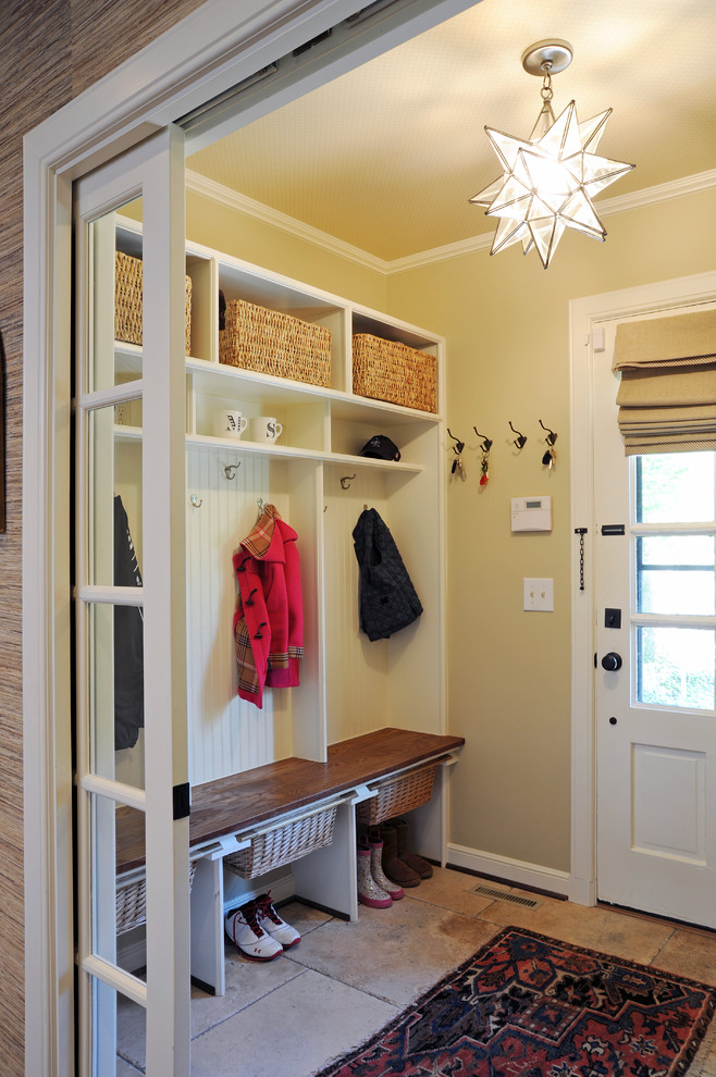 Example of a classic beige floor entryway design in Columbus with beige walls and a white front door