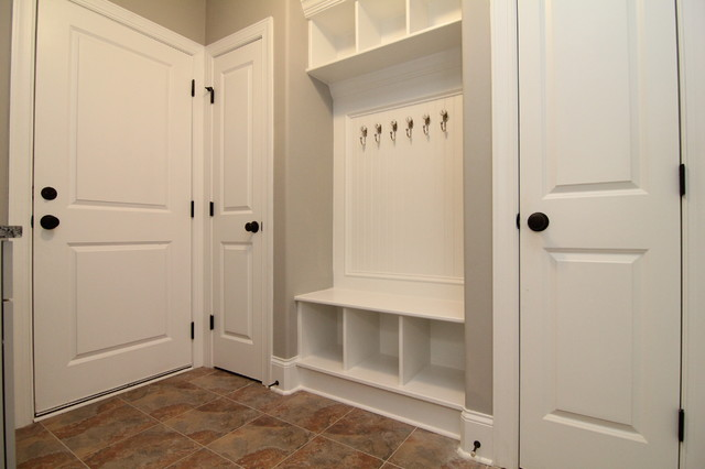 Example Of A Mid Sized Clic Ceramic Floor Entryway Design In Raleigh With Gray Walls