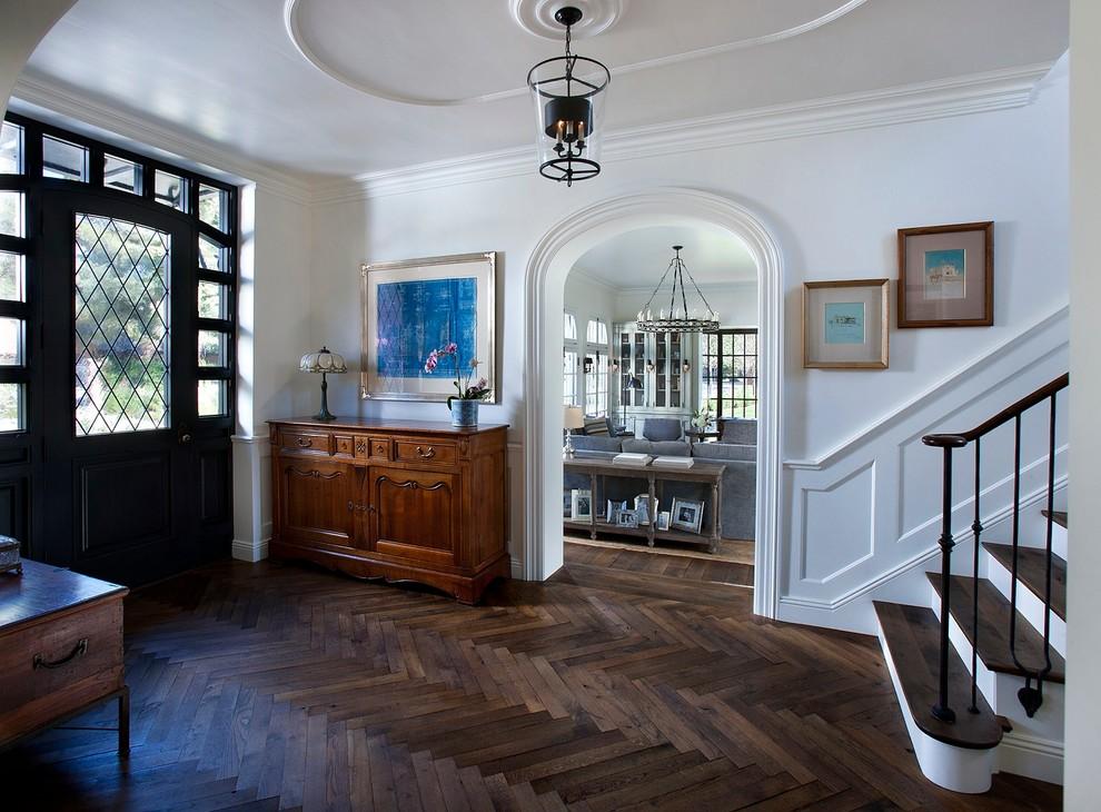 Mid-sized elegant dark wood floor entryway photo in Phoenix with white walls