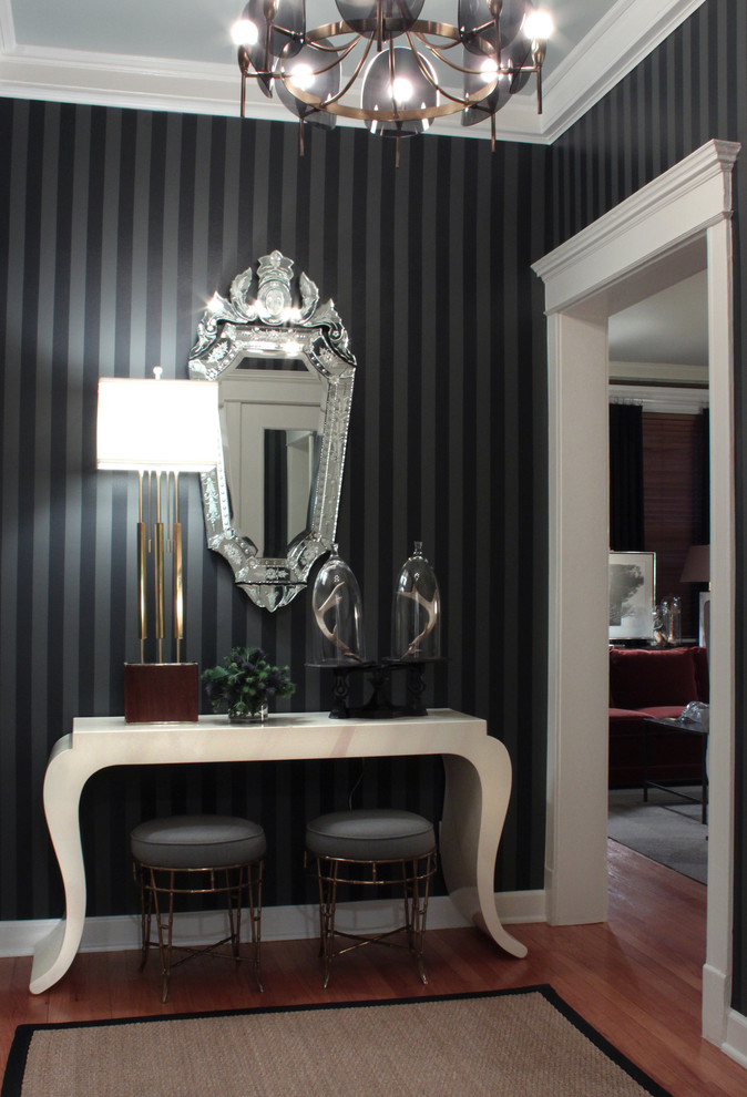 Inspiration for a transitional medium tone wood floor entryway remodel in Chicago with black walls
