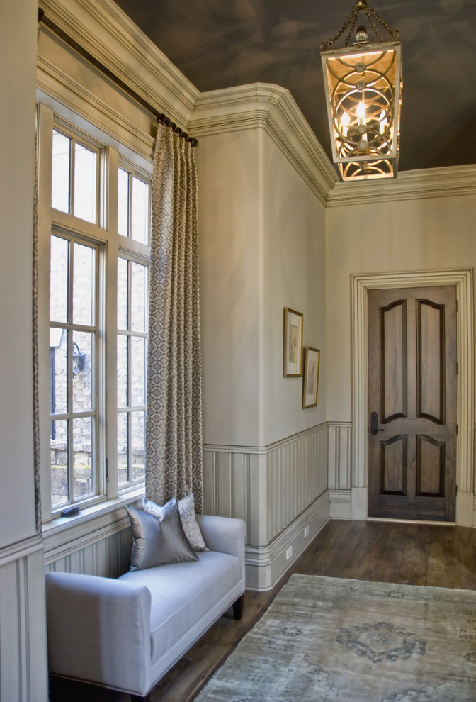 Example of a transitional entryway design in Atlanta with beige walls