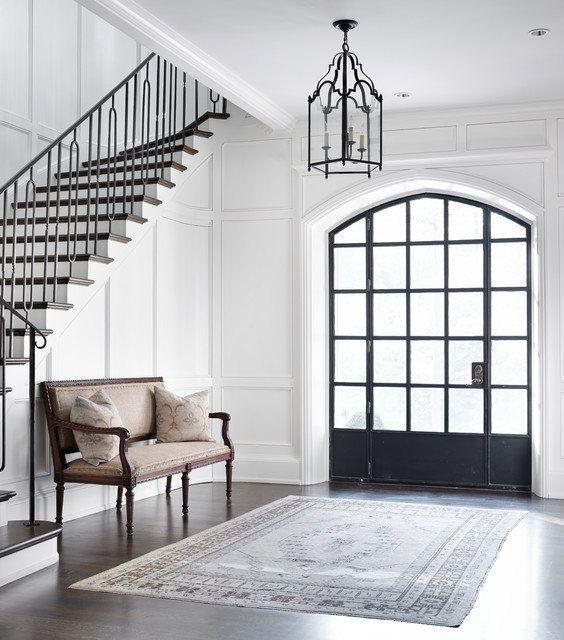 Example of a transitional dark wood floor foyer design in Atlanta with white walls