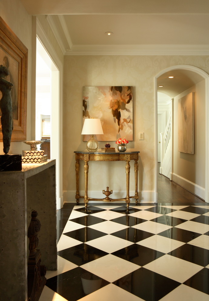 Example of a classic multicolored floor entry hall design in Atlanta with beige walls