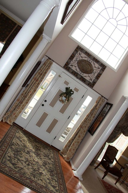 Two story foyer for All side windows