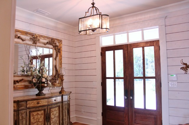Inspiration for a light wood floor entryway remodel in Other with white walls and a dark wood front door