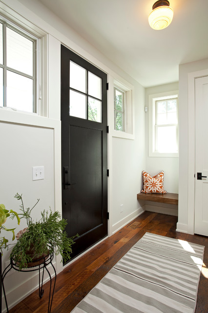 Farmhouse brown floor entryway photo in Minneapolis with white walls