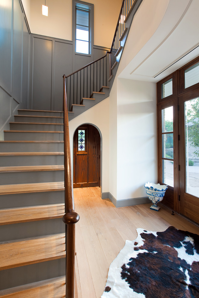 Inspiration for a timeless light wood floor foyer remodel in Austin with gray walls and a glass front door