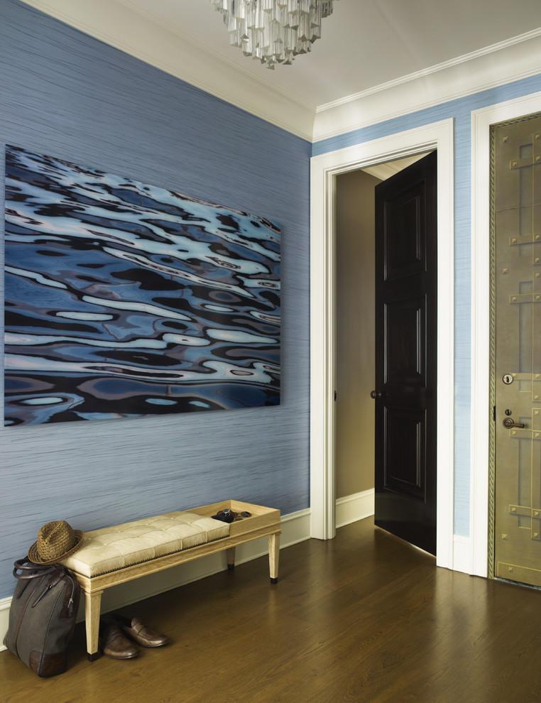 Eclectic dark wood floor entryway photo in New York with blue walls