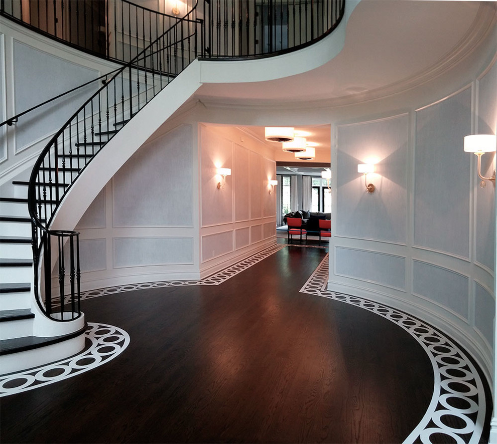Large transitional painted wood floor foyer photo in New York with white walls