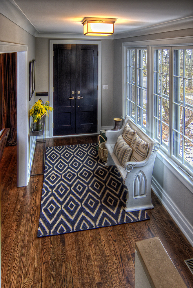 Elegant foyer photo in Chicago with gray walls