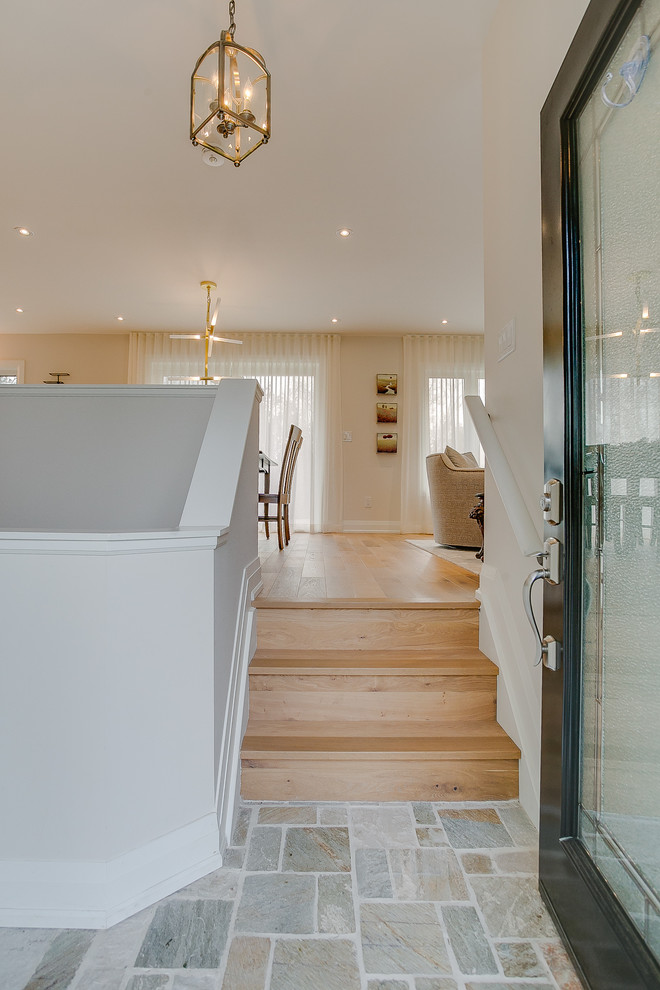 Entryway - small transitional limestone floor and multicolored floor entryway idea in Toronto with white walls and a glass front door