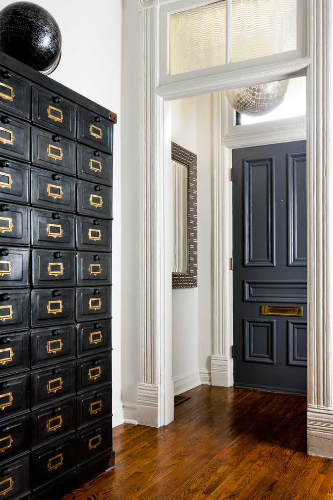 Ornate entryway photo in Toronto with white walls