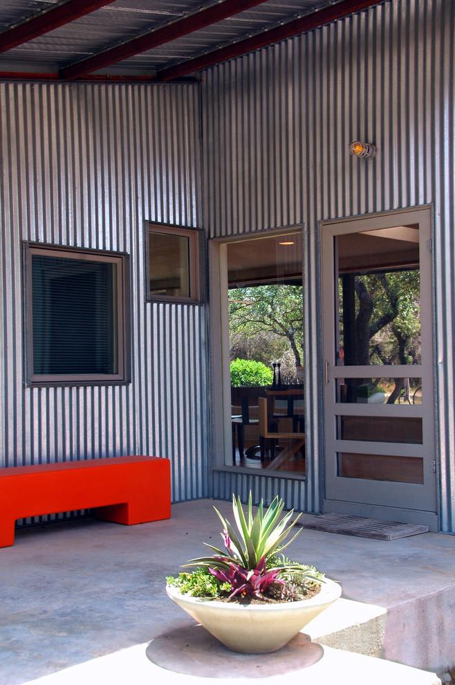 Entryway - industrial entryway idea in Austin