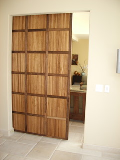 Walnut and zebra wood hanging door contemporary interior doors los angeles by upstairs for Modern interior doors los angeles