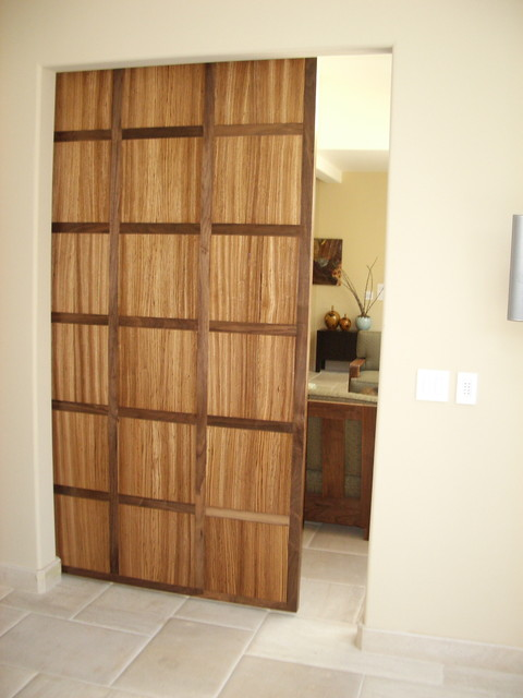Walnut And Zebra Wood Hanging Door Contemporary Entry