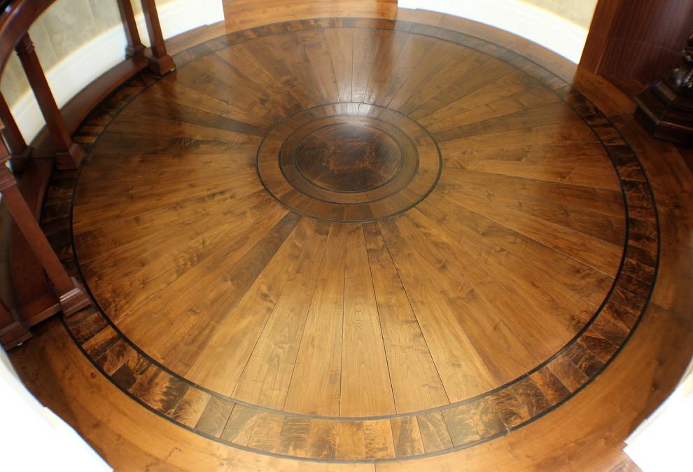 Example of a mid-sized classic medium tone wood floor foyer design in Salt Lake City