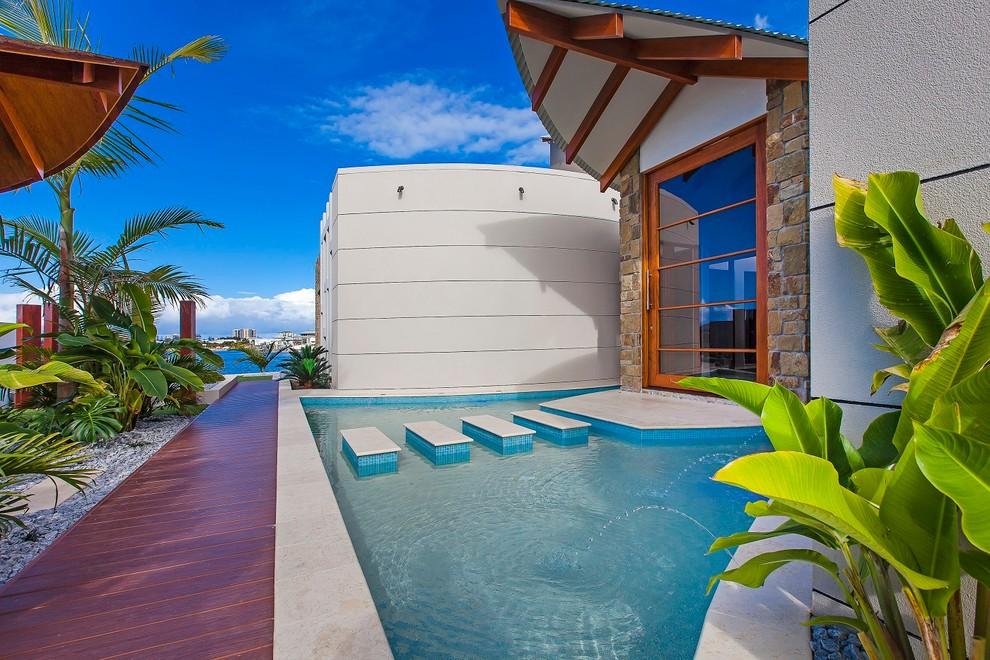 Pivot front door - tropical pivot front door idea in Sunshine Coast with a glass front door