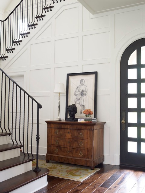 Inspiration for a timeless dark wood floor entryway remodel in Houston with white walls and a black front door
