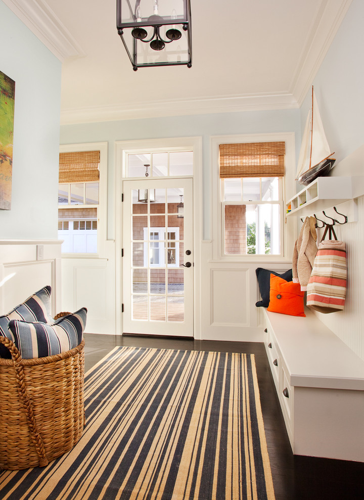 Large beach style dark wood floor entryway photo in Portland with blue walls and a glass front door