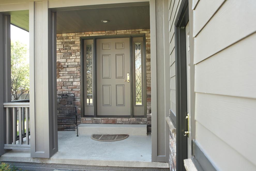 Mid-sized trendy concrete floor single front door photo in Other