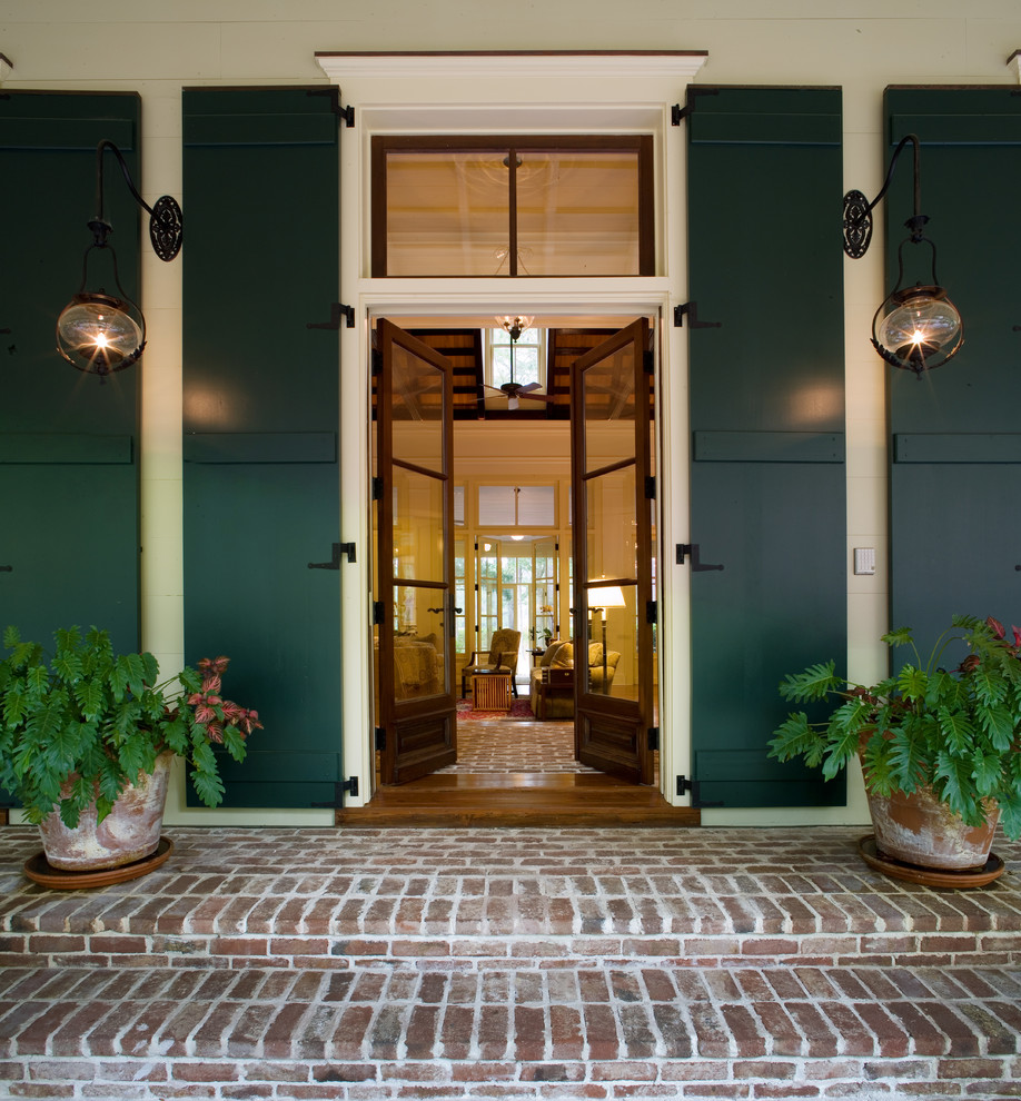 Inspiration for a timeless brick floor entryway remodel in Atlanta with a glass front door