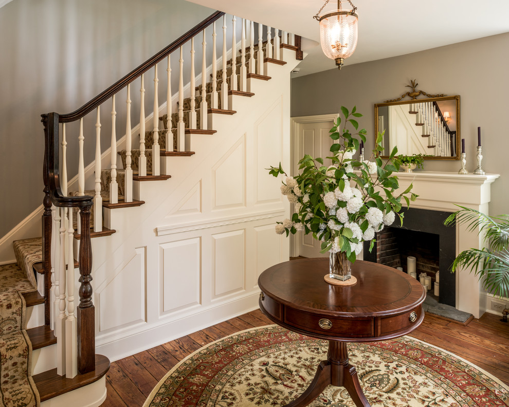 Foyer - small traditional dark wood floor foyer idea in Philadelphia with gray walls