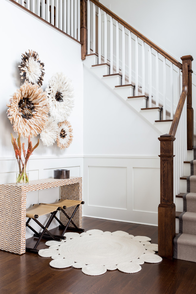 Large trendy medium tone wood floor and brown floor entryway photo in New York with white walls and a white front door