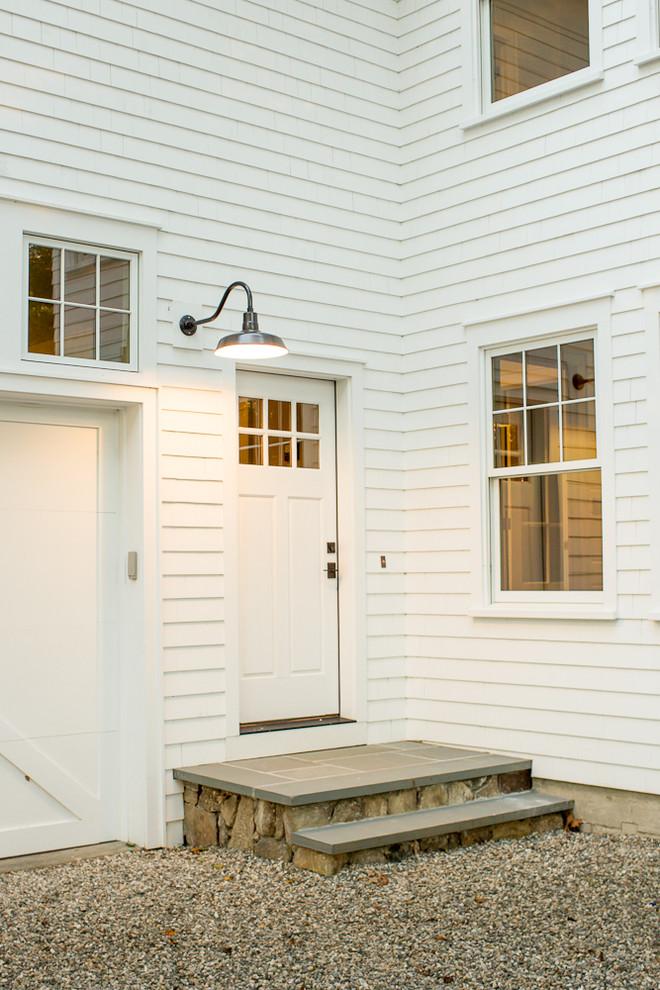 Example of a farmhouse single front door design in Bridgeport