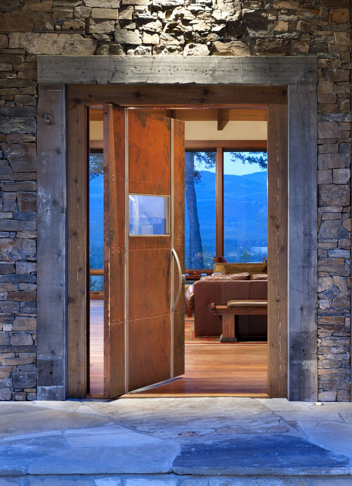 Example of a mountain style entryway design in Other with a metal front door