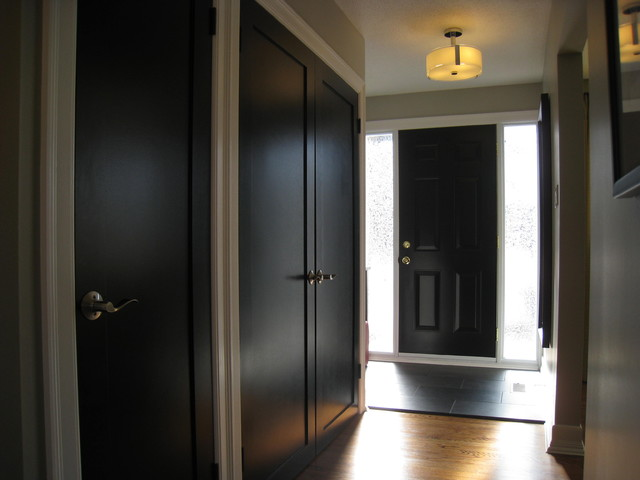 Black Foyer Doors : Wider view of hall with black doors contemporary entry
