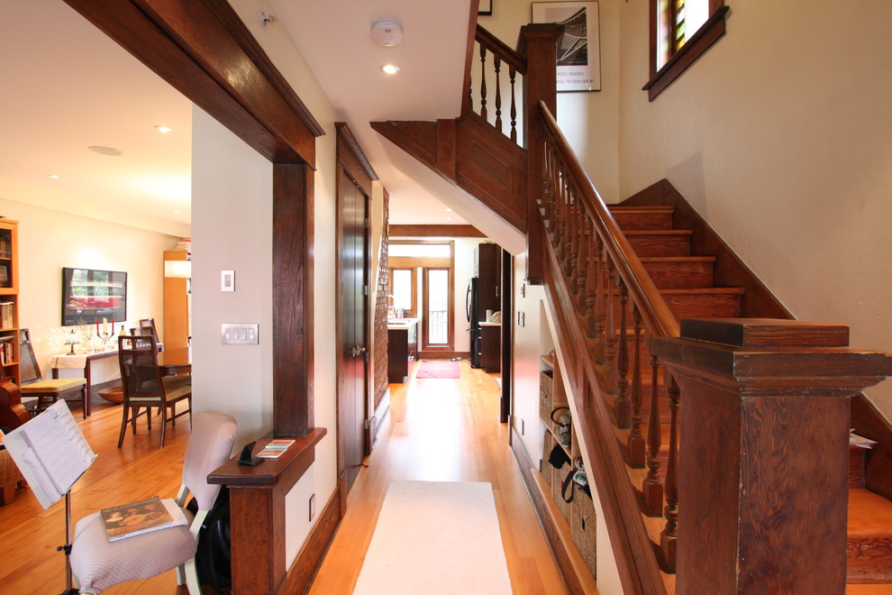 Mid-sized elegant light wood floor entryway photo in Vancouver with gray walls and a dark wood front door