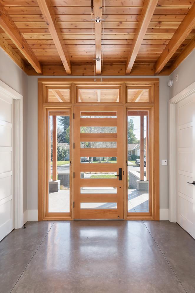 Mountain style concrete floor single front door photo in San Francisco with a light wood front door