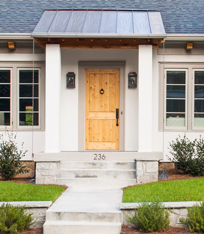 Inspiration for a mid-sized transitional entryway remodel in Atlanta with a light wood front door