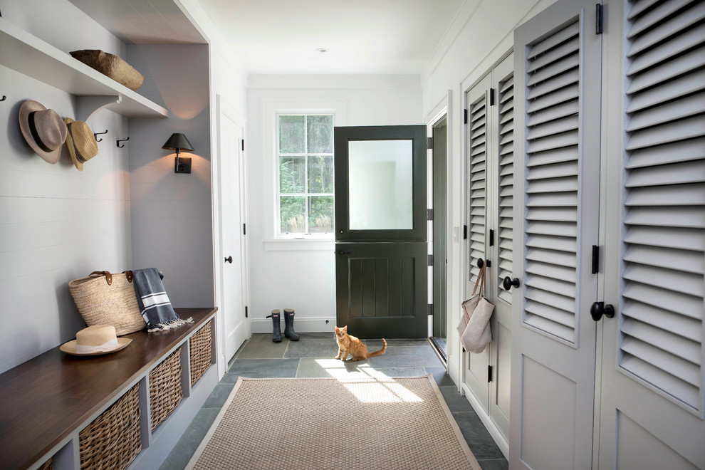 Entryway - transitional slate floor entryway idea in Raleigh with white walls and a black front door