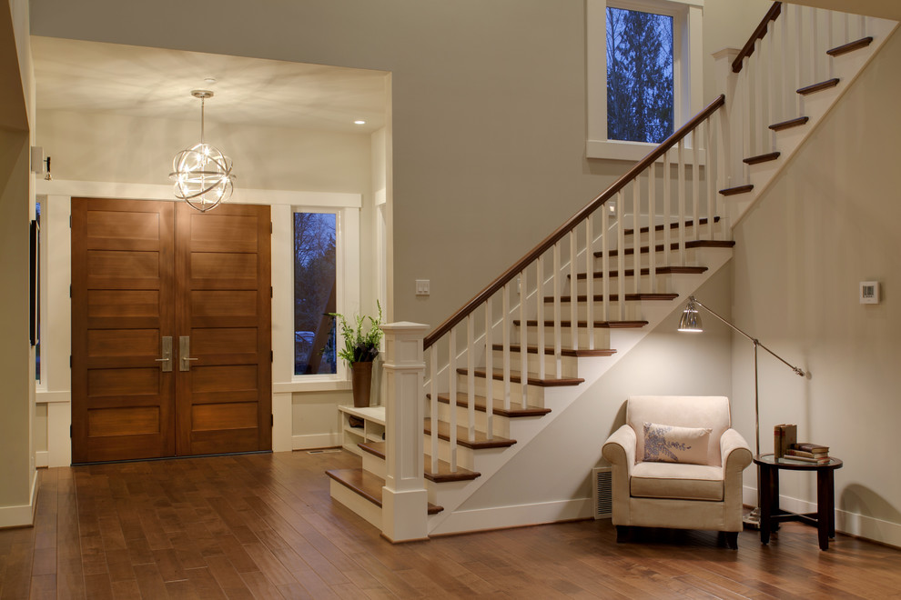 Entryway - transitional entryway idea in Seattle with beige walls and a medium wood front door