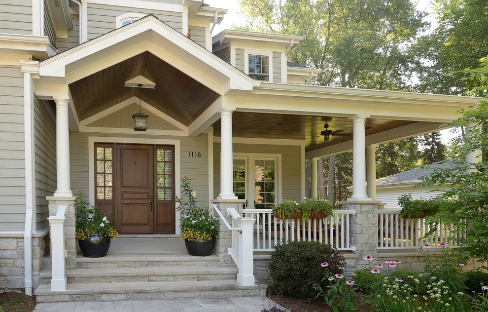Inspiration for a timeless single front door remodel in Chicago with a dark wood front door