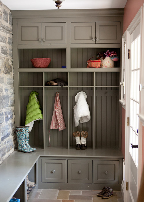 Organized mudroom with coats and boots
